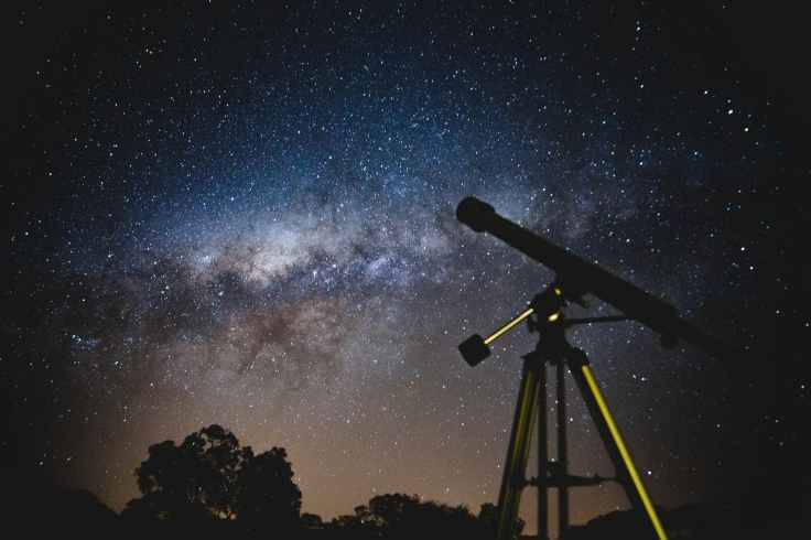 black telescope under blue and blacksky