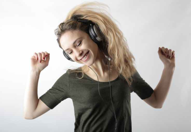 woman wearing black headphones