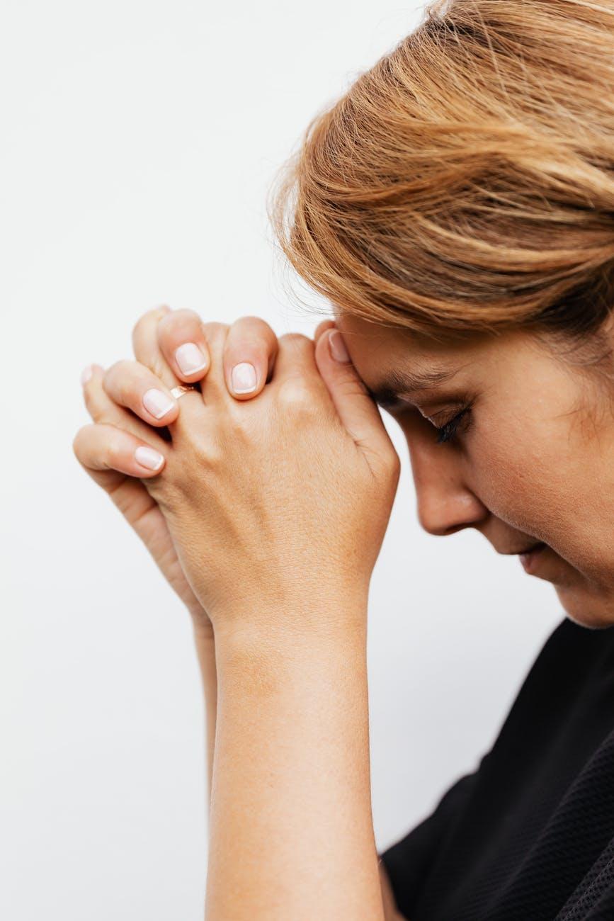 close up shot of a woman praying